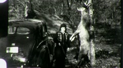 WOMAN Hunter Dead DOE ELK Deer in Woods FOREST 1940 Vintage Film Home Movie 1317 Stock Footage