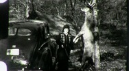 Stock Video Footage of WOMAN Hunter Dead DOE ELK Deer in Woods FOREST 1940 Vintage Film Home Movie 1317