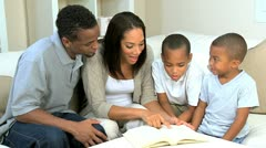 Parents and Little Ethnic Boys Reading a Book Stock Footage