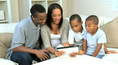 Young Boys and Their Parents With a Wireless Tablet Stock Footage