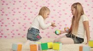 Happy two girls playing in the childrens room Stock Footage