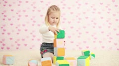 Girl playing in the childrens room Stock Footage