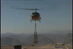 UH1 Huey Sling loads 08 Stock Footage