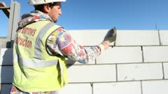 Construction. Bricklayer working on construction site. Stock Footage