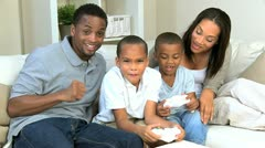 Young Ethnic Family Playing Electronic Games Stock Footage