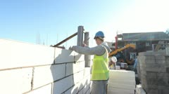 Construction. Bricklayer working on construction site. - stock footage