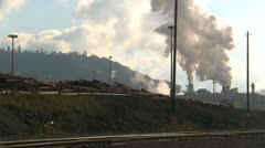 Steam rising above lumber mill, #2 Stock Footage