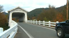 Grave Creek covered bridge and traffic Stock Footage