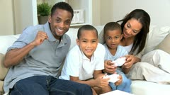 Young Family Having Fun with Electronic Game Console Stock Footage
