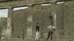 Couple examine statue in Pompeii (2 clips) Stock Footage