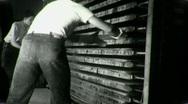 Stock Video Footage of Workers MEN UNLOAD Lumber Factory FURNACE 1940s (Vintage 16mm Film Movie) 1341