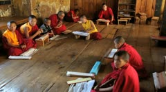 Young monks studying, Pana, Bhutan, Asia Stock Footage