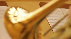 Musician reads notes and plays trombone. Stock Footage