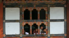 Young children at a window, Wangi, Bhutan, Asia Stock Footage