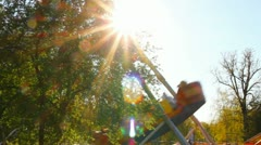 Big swing in park against sun Stock Footage