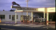 Car Pulls out of Gas Station Depot Petrol 1940s Vintage Film Home Movie 1367 Stock Footage