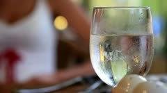 Wine, water glass condensation close up, closeup couple dinner restaurant Stock Footage