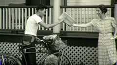 Stock Video Footage of PAPERBOY DELIVERS DAILY NEWSPAPER 1940 (Vintage Old Film Home Movie) 1377