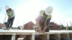 Stock Video Footage of Construction. Carpenter working on construction site.