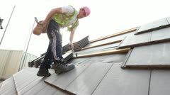 Construction. Roofer - stock footage