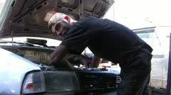 Auto mechanic repairing a car Stock Footage