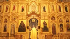 Russian Orthodox Church. The iconostasis. The priest - stock footage
