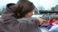 Stock Video Footage of Girl Shooting Rifle