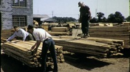 Stock Video Footage of MEN WORK LUMBER YARD Construction Industry 1960 (Vintage Film Home Movie) 1401