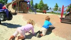 Toddler boy throws sand on sister-MVI 9780 Stock Footage