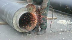 Worker cutting pipe with grinder Stock Footage