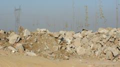 Dipper of excavator scoops stones Stock Footage