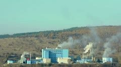 Industrial factory with chimneys and smoke in the forest Stock Footage