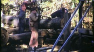 Portable Sawmill and Workers Circa 1950 (Vintage Film 16mm Footage) 1404 Stock Footage