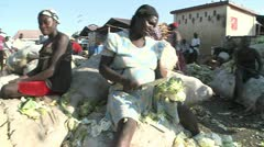 Poor Haitians live on the streets of Haiti following a devastating earthquake. - stock footage