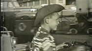 Stock Video Footage of Boy Cowboy Suit Amusement Park Ride 1950s (Vintage Film Home Movie) 1408