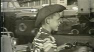 Boy Cowboy Suit Hat Amusement Park Ride 1950s Vintage Film Home Movie 1408 Stock Footage