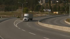 transport truck follow around curve on bridge - stock footage
