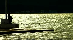 Fishermen on the sea at sunset Stock Footage