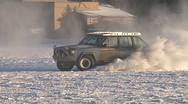 Stock Video Footage of Rapscallion Driving Crazily on Snowy Ice Lake 1