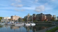 Victoria harbor, autumn afternoon, Empress hotel and sailboats Stock Footage