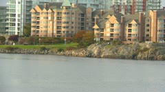 Float plane taxis in front of condos Stock Footage