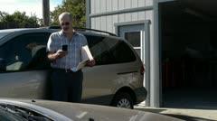 Auto adjuster using smart phone Stock Footage