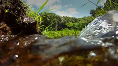 Pure fresh clean water pours down a stream. - stock footage