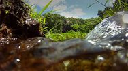 Pure fresh clean water pours down a stream. Stock Footage