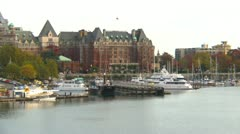 Empress hotel from harbor and float plane, zoom back Stock Footage