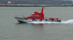 Marine transportation, pilot boat, paralleling alongside, match speed Stock Footage