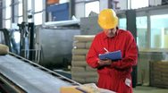 Warehouse Worker in Red Overalls Stock Footage