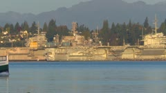 Military, aircraft carriers, US Navy in dock, ferry through frame Stock Footage