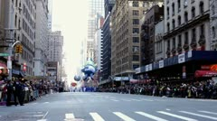 Gazer the Elf going down street with large crowds Stock Footage
