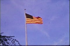 American Flag blowing in the summer wind, Vintage 8mm film Stock Footage